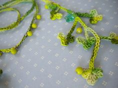 Crochet Shamrock Necklace showing a good step by step as well as a pattern.