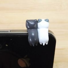 Cute Cat Lovers Pre-roll Anti Dust Plug - 3.5mm Phone Dust Stopper Earphone Cap Headphone Jack Charm for iPhone 4 4S 5 HTC Samsung. $4.99, via Etsy.
