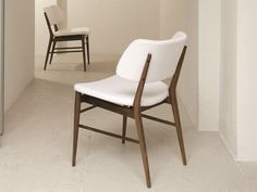 Upholstered chair NISSA Logos Collection by Porada | design MARCONATO