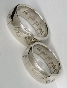 "Wedding rings! The elvish engraving says: ""One ring to show our love, one ring to bind us, one ring to seal our love and forever entwine us."""