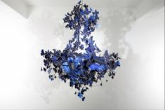 Made of sapphire-blue solar panel cells, this chandelier is intrinsically self-sustaining, as it absorbs the energy of daylight to fuel its own illumination.