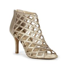 263bc73053 Luxurious gold caged heel with plush foam cushioning for all-day comfort  Caged Heels,