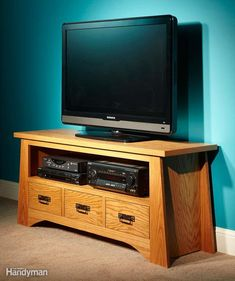 This handsome TV stand will organize all your electronic clutter and DVDs. It's an ideal project for a DIYer, and you can complete it in just one weekend. Me? I'd call my handyman! | Tiny Homes