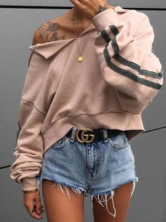 Distressed hoodie: Millennial pink ripped and distressed off the shoulder hoodi with denim shorts frayed at the ends with a Gucci black belt.