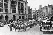 Battle of Singapore, February 1942. Victorious Japanese troops march through the city center.