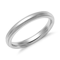 This narrow 14k white gold wedding ring features a fine milgrain edge on either side of the raised center band.