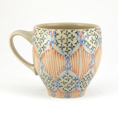 Dawndish Ceramic Teacup - Mug with Bright Blue, Navy Blue and Orange Pattern  ...   ** This would make a good ceramic painting project. ~ Ruth **