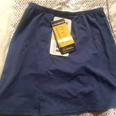 NWT Kaelin Tennis Skirt New with tags attached MSRP $50 blue workout skirt with elastic waistband and special material that wicks away sweat and moisture keeping you dry while working out. Kaelin Skirts