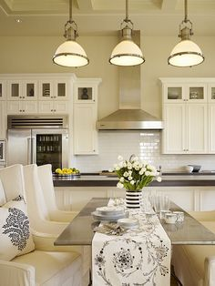 Kitchen - Love the pendant light fixtures, white cabinetry & subway tile back splash, the stainless steel hood/appliances and the casual dinette seating....this is one kitchen any cook would love.
