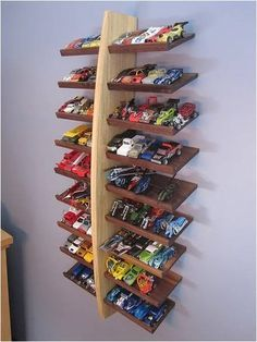 No more stepping on little toy cars at night! This hot wheels parking shelf holds up to 100 cars. Click here to find out how to make this shelf.