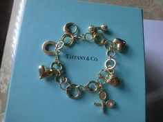 Authentic Tiffany & Co 18k yellow Gold & Diamond Charm Bracelet #TiffanyCo #charm