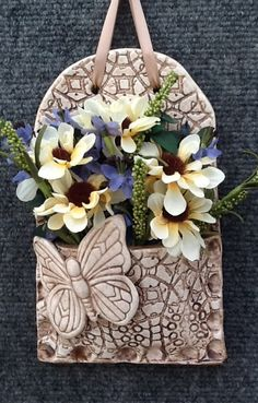 """Pretty Pottery"". Wall pocket by designer/craftsman Trudi Clark"