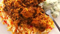 Chicken Biryani cooked the South African way.This fragrant, spicy rice and chicken is definitely a special occasion dish and a crowd pleaser Oven Chicken, Chicken Spices, Chicken Marinades, Butter Chicken, Chicken Recipes, Baked Chicken, South African Recipes, Indian Food Recipes, Gourmet Recipes
