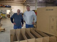 Marty Pupalitis Sr. and Carl Boettcher building HTS Ultra-Rack corrugated shipping boxes for customer orders.
