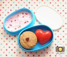 And here's another morning nutrition break bento. Again, she had a homemade apple and cinnamon muffin (I'll post the recipe Wednesday) with a fruit leather heart on it. Some yogurt with heart sprinkles, and a plastic heart filled with craisins.    MEET THE DUBIENS