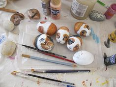 Guinea pigs painted on rocks.