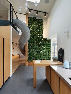 KI Design Studio adds slide and plant-covered wall to Ukraine apartment