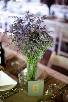 Purple Flower Wedding Centerpiece - these would look good in wine bottles.... what kind of flower are they?