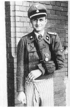 Obersturmführer Hubert-Erwin Meierdress, commander of Stug.Bty SS-Div Totenkopf, photographed on the hospital steps while recovering from the wounds received while in the Demyansk Pocket where his actions would earn him the Knights Cross. He wears the standard SS pattern double-breasted field grey jacket for SPG personnel.