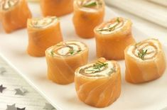 Smoked salmon cheese wheels  200g Smoked Salmon slices 1 x 150g tube of squeezy cheese like Primula Cheese and Prawn, or cream cheese mixed with a little lemon juice 1 small pack of fresh dill  On a board lay out the smoked salmon. Pipe the cheese back and forth over the surface of the fish. Starting from the top edge, carefully roll the smoked salmon and cheese up to make a long sausage. Place into a container and pop in the freezer for 20 minutes to firm up.