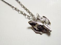 I actually have this necklace! Love it! Wolf necklace