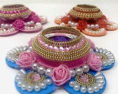 Diwali Pooja, Diwali Diy, Diwali Party, Thali Decoration Ideas, Diwali Decorations, Acrylic Rangoli, Rangoli Designs Flower, Candle Holder Decor, Floating Flowers