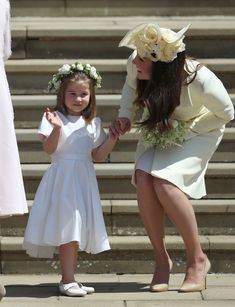 Kate Middleton Photos - Princess Charlotte and Catherine, Duchess of Cambridge leave St George's Chapel after the wedding of Prince Harry and Meghan Markle in St George's Chapel at Windsor Castle on May 19, 2018 in Windsor, England. - Prince Harry Marries Ms. Meghan Markle - Windsor Castle