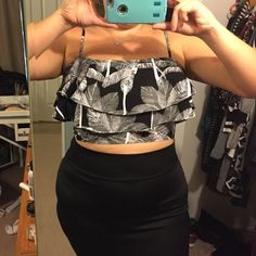 Ruffle crop top Cute black and white tropical print ruffled adjustable strapped exposed rear zipper crop top. Will best fit a small/ medium size chest. 36-38. Junior sized xl. Non stretch Tops Crop Tops