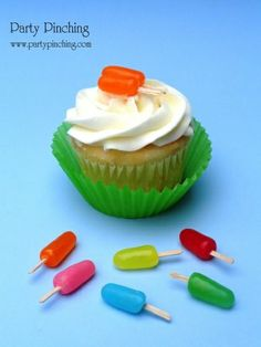 These cute little popsicle cupcake toppers were made from flat toothpicks pushed into Mike and Ike candies. What a cute idea!!
