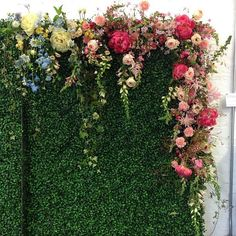 Close up of the floral draped boxwood wall by Sullivan Owen Floral