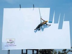 A clever Berger paints billboard advertisement playing on the truly natural tones of their colors.