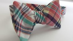What's not to love about this Madras Plaid Bow Tie! It will make a great addition to your collection!