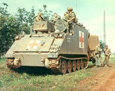 """ambulance 11 ACR """"Blackhorse"""" Track is participating in a search and destroy mission near Xuan Loc , east of Saigon /US Army photo archive/. Vietnam History, Vietnam War Photos, Army Vehicles, Armored Vehicles, Army Medic, Combat Medic, Brown Water Navy, North Vietnam, Armored Fighting Vehicle"""