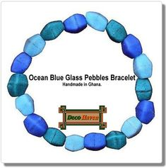 Ocean Blue Glass Pebbles Bracelet  - These beads are handmade from recycled glass using ancient traditions and has a clear elastic band.