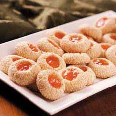 Apricot Sesame Cookies Recipe -This recipe is a favorite of mine to make for special occasions. The cookies freeze beautifully, so they can conveniently be made ahead of time. Substitute peach, strawberry or raspberry jam if you like.