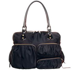 Named after our favorite mother of triplets, the award-winning Kate is the bag for the woman that needs to be prepared. With six exterior and ten interior pockets, Kate is the ultimate travel, overnight, gym, work, baby, or everyday bag. In classic black Bedford Nylon with custom MZ Wallace gold hardware, it's perfect for every season. Finished with our signature red edge-dye.