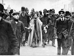Pankhur(s)t's arrest! Never looked better than when under arrest-- looking glorious, like such a diva! Dame Pankhurst UNDER ARREST.