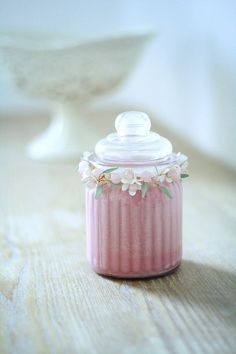 This is a beautiful 6oz. /180ml ribbed glass jar with lid, filled with eco soy wax in lovely rose pink colour paired with eco cotton wick. It is scented with rose, jasmine, cedarwood and white musk paraben free fragrance oil. I adorned the neck of the jar with hand wired flowers and leaves and light pink rose quartz gemstone beads. I made the tiny flowers and leaves myself from resin. This would make a lovely gift, wedding favour, or compliment any table setting   Soy wax burns much long...