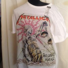 METALLICA Tshirt Brand New With Tag Brand new And Justice For All Metallica Tshirt from Hot Topic. Nothing wrong with it. Just downsizing my huge collection. My loss your gain!  Tops Tees - Short Sleeve