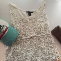 See-through white lace top See-through white tank top, perfect as a beach coverup or for an everyday outfit with a white tank top underneath. Hat listed separately Forever 21 Tops Tank Tops