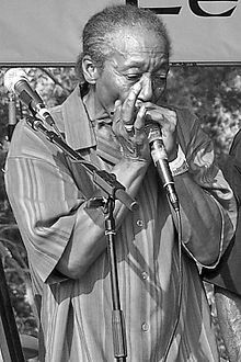 "Willie ""Big Eyes"" Smith (January 19, 1936-September 16, 2011) was a Grammy Award-winning electric blues vocalist, harmonica player, and multi-award winning drummer. He was best known for several stints with the Muddy Waters band beginning in the early 1960s. His harp playing can be heard on Bo Diddley's ""Diddy Wah Diddy."""
