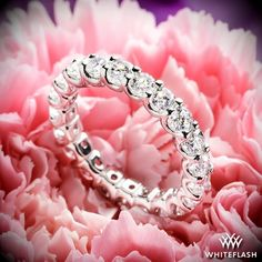 "A brilliant display of bling, the ""Annette's U-Prong"" Eternity Diamond Wedding Ring  is an all around stunner!  Bursting at the seams with dazzling A CUT ABOVE® Hearts and Arrows Diamond Melee this ring is sure to leave her with a smile."