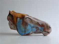 """""""Of Water and Dust"""" by Nichola Theakston.  Reminiscent of Nic Fiddian-Green's massive horse head sculpture """"Horse at Water"""", this minimalist sculpture has a studied meditative air. #art #blue #terracotta"""