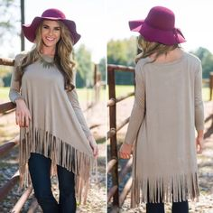 """NWOT Tan Tassel Fringe Boho Long Sleeve Top XL NWOT Tan Tassel Fringe Boho Long Sleeve Loose Top, Size XL. Bust 42 1/2"""", Shoulder 17"""", Sleeve 23 1/2"""", Front Length 32"""", Back Length 40"""". I'm offering 30% off 2 items or more OR 4/$20 on the red dot items. Also, you can use the red dot items to make my discount of 30% off 2 items or more kick in  Tops Tunics"""