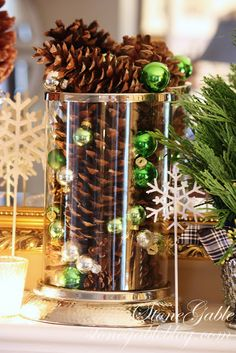 tiny glass balls and pine cones in a large vase