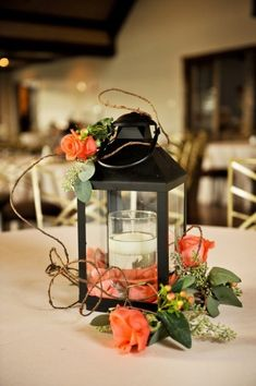 Love the idea of the florals loosely twining around the lantern!