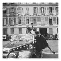 Vogue - August 1954 by Jacques Boucher Suzy Parker in Chanel, leaning into her MG outside the French Vogue office