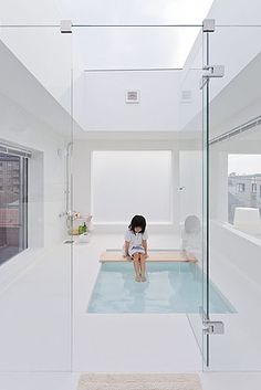 Beautiful white modern japanese bathroom. All prept for mediation - love it!