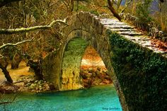 "Stone Bridge over the Voidomatis in Greece        Kleidonia (or Voidomatis - meaning ""Mother of water"") stone bridge.  It is an one-arch stone bridge, situated on the river Voidomatis near the village of Kleidonia, at the end of Vikos Gorge in Greece. It was constructed in 1853 by Misios."