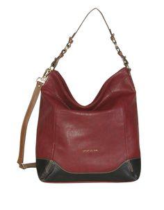 Shopper grande combinado tres colores: granate, negro y asa marrón. Su éxito radica en su tamaño y la combinación de colores.